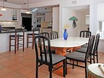 This sunlit open gourmet kitchen delights and welcomes all