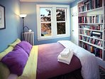 This cozy 2nd floor library bedroom offers river views, great bestsellers and eclectic reads