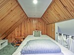 This bed in the loft can accommodate extra guests.