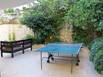 Table tennis at the back of the property