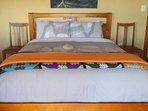Queen bed in main area.