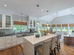 Chef's Kitchen with Breakfast Bar, Sun Room, TV to the right