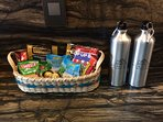 Snacks and bottled water stocked daily.  Aluminum water bottles for your adventures, our gift to you
