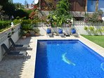 Our spacious pool, terrace and garden with sunloungers
