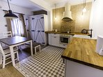 Kitchen with air conditioning and amenities like fridge, oven, glass-ceramic cooktop, microwave, was