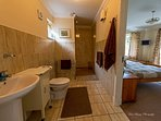 Large walk in wet shower room at Briar Steading. Jack + Jill doors enables it as twin en-suite