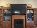 60' TV. snuggle up and  sit by the fireplace  and catch up on reading or watch premium direct TV