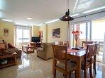 Lounge area with flatscreen smart TV, UK channels and fabulous sea views.