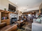 """The living room is comfortably equipped with a large plush couch, fireplace, a Samsung 39"""" HDTV, Toshiba Surround Sound..."""