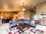 """The living / family room features a large and plush L-shaped couch, river rock fireplace and a 55"""" HDTV. This home is a..."""