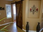 Newly installed barn door to Queen bedroom
