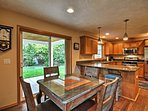 You'll have easy access to the backyard through the sliding doors in the dining area.