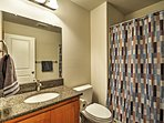 Freshen up for the day in this full bathroom.