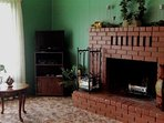 Comfortable living room with cozy fireplace - DVD & VHS player with free movies available