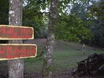 Directional signs by the creek