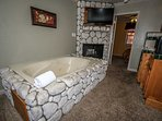 Jetted tub and fireplace