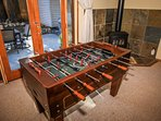 Foosball table and wood burning fire stove