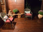 Large front porch with wicker seating