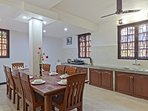 Dining table with fully equipped kitchen