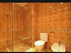 Large bathroom with walk-in shower, toilet, bidet & basin. Separate additional toilet also.