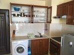Fully equipped kitchen including washing machine and large fridge freezer.