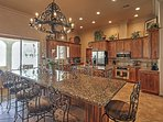This granite center bar serves as a dining table, seating up to 12 people!