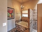 The second master bathroom also features a bath tub and a walk-in shower!