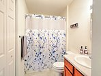 Freshen up for the day in this pristine full bathroom.