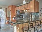 Granite countertops fill the kitchen.