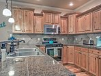 The fully equipped kitchen is the perfect spot to whip up tasty recipes.