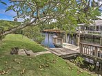 The west side of the home presents beautiful water views and easy dock access to the canal flowing to the Gordon River...