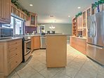 Show off your cooking skills in the fully equipped kitchen, complete with an island for extra counter space!
