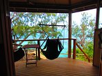 french doors to your balcony with hanging chairs to enjoy the view