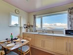 Kitchen with dining table and sea views too!