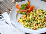 Healthy breakfast of scrambled eggs with fresh veggies from the market
