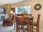 Quaint dining table with seating for 4 guests and the option to extend the table for more space.