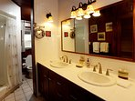 Master bath with dual showers and sinks.