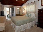 Guest bedroom with view of ocean surf from bed.