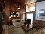 Living room with tall vaulted koa wood ceilings.