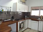 Full kitchen facilities include gas cook top, electric oven, microwave, dishwasher and fridge