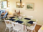 Dining area for 6 is handy to the kitchen and living area.