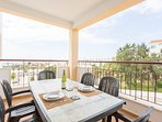 Spacious outside dining with views to ocean, marina and town.