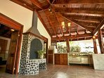 Pool house kitchen with fireplace and fire pit,  gas grill / griddle great for entertaining