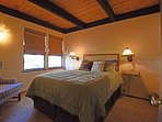 Guest bedroom with a queen bed on the ground floor