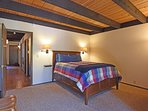 Another guest bedroom with a queen bed on the ground floor