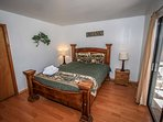 Bedroom 1: Queen Bed, Deck/Backyard Access- 1st Level