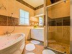Bathroom with spa bath and shower