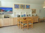 Living/Dining area with 49' TV, Blu-ray player, radio/CD player, books and games