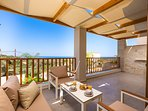 The veranda is equipped with patio furniture!
