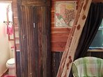 Sliding barn door to the bathroom made of 1920's beaded boards.  For more photos search the web